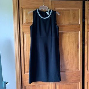 Black dress with pearl details